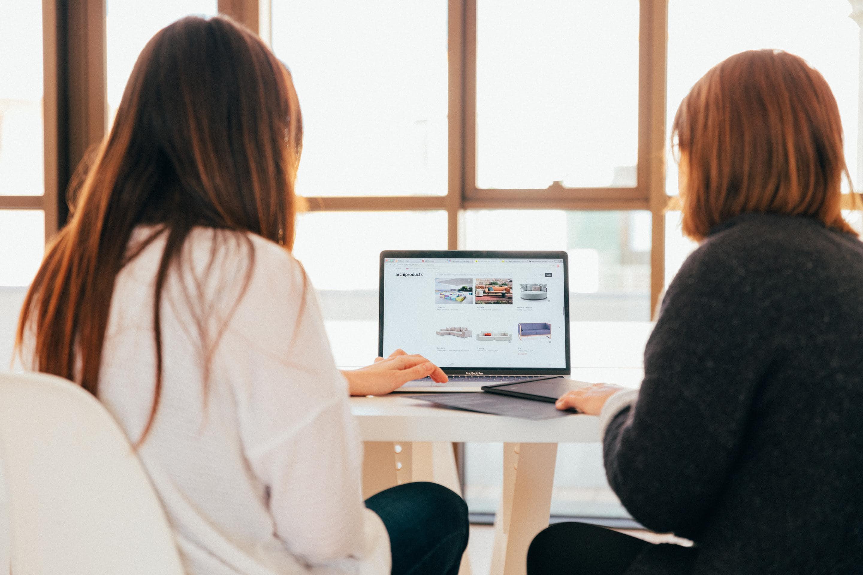 Women Looking At Laptop