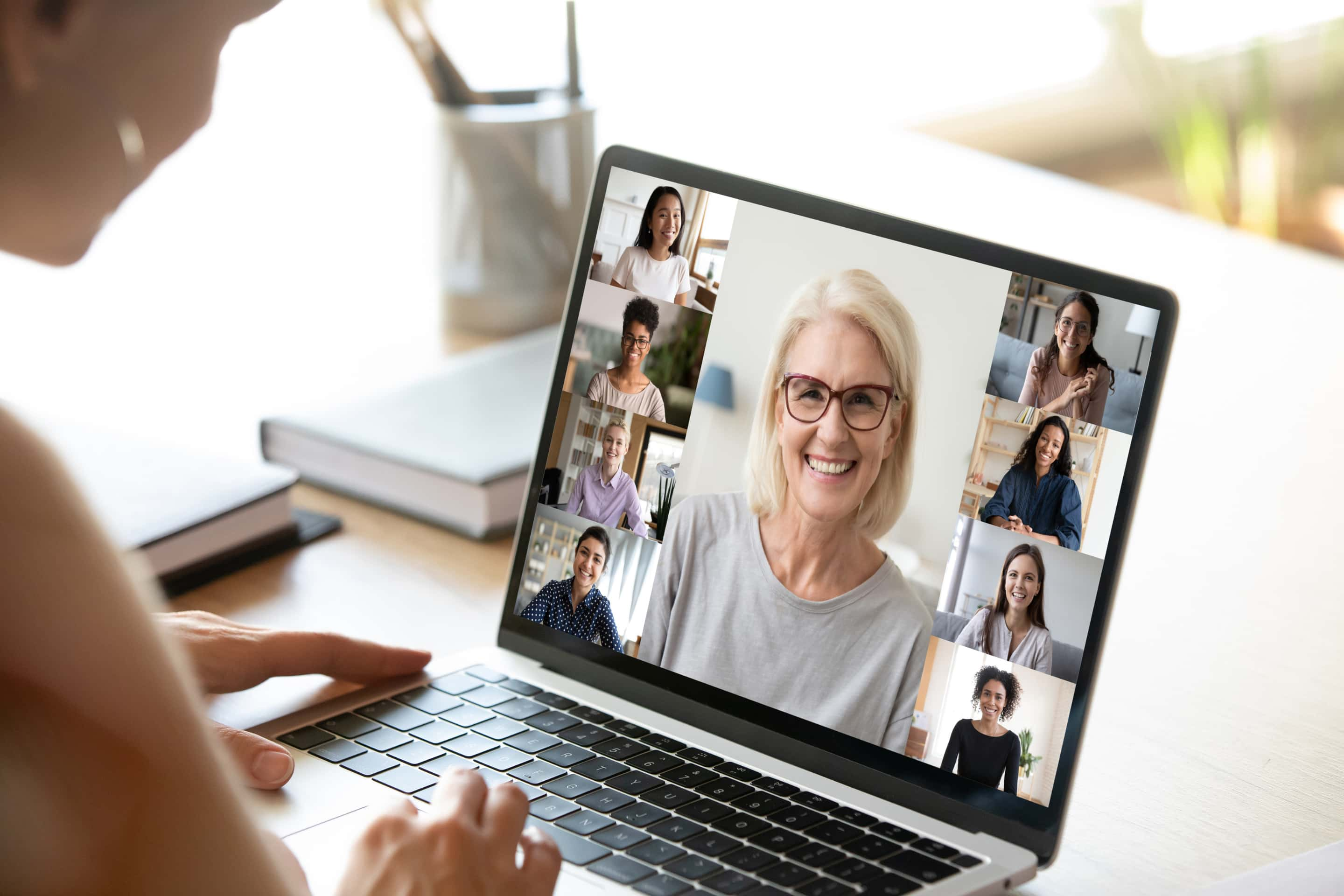 Diverse Woman Involved In Group Videocall, Laptop Screen View